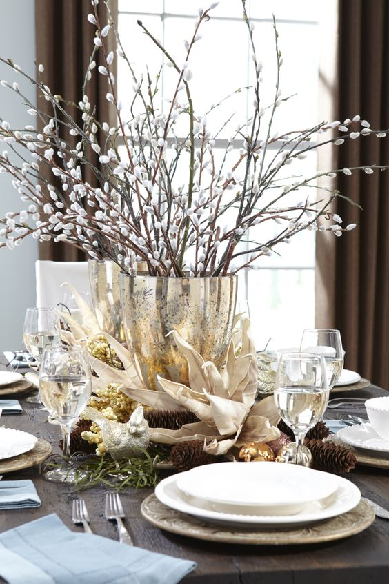 a refined spring centerpiece of a gold vase and willow is a traditional and cool idea for spring