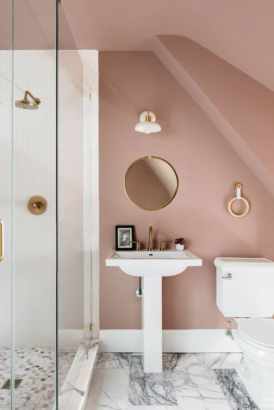 a romantic mauve bathroom with a shower space, white appliances, round decor