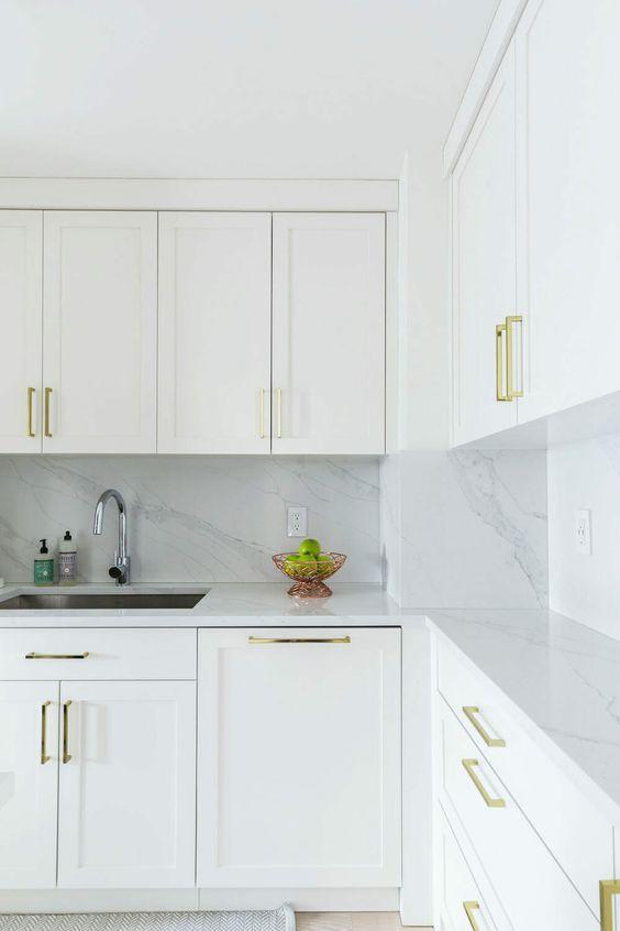 a minimalist white kitchen design