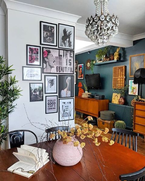 a smal gallery wall with pop art and matching black frames is a cool way to accessorize the space and make it cool