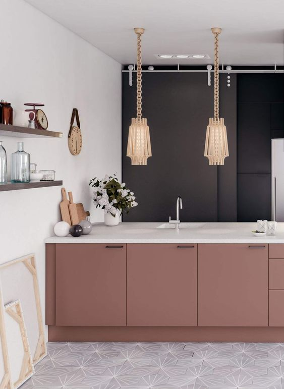 a sophisticated kitchen with a black wall, mauve cabinetry with white coutnertops, beautiful lamps on chain