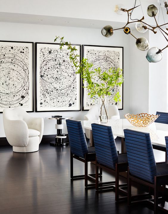 a statement gallery wall with black frames, matching pictures and small white matting is a bold solution for decor