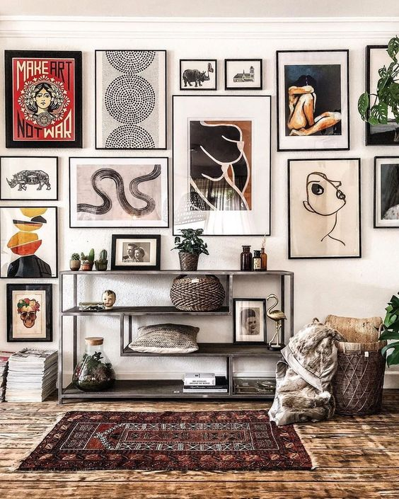 a statement gallery wall with thin black frames and black and white matting built around a central piece