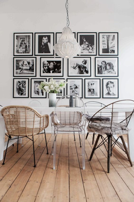 a stylish gallery wall with matching black frames and black and white farmily pics is a very cool idea to enjoy