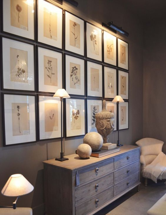 a stylish grid gallery wall with thin black frames, white matting and neutral botanical prints to add a bit of vintage to the space