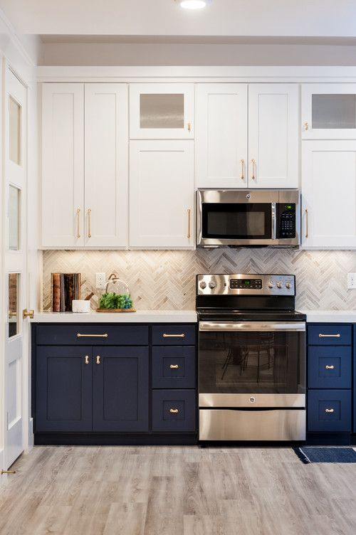a stylish navy and white one wall kitchen with a grey tile backsplash and a white stone countertop plus built-in lights