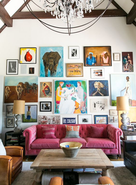 a super bright gallery wall with bold artworks with frames and without them, in bold colors and with a free form for a creative touch