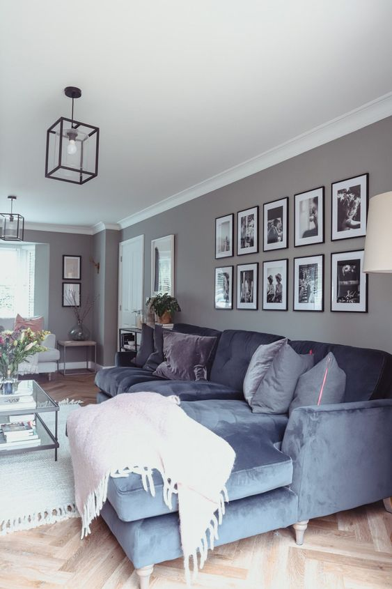a symmetrical gallery wall with matching black frames and black and white pictures is always a good idea for an elegant touch