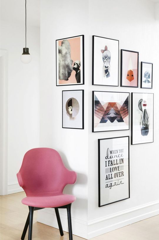 a truly interesting gallery wall with thin black frames and colorful modern prints is a catchy idea to go for