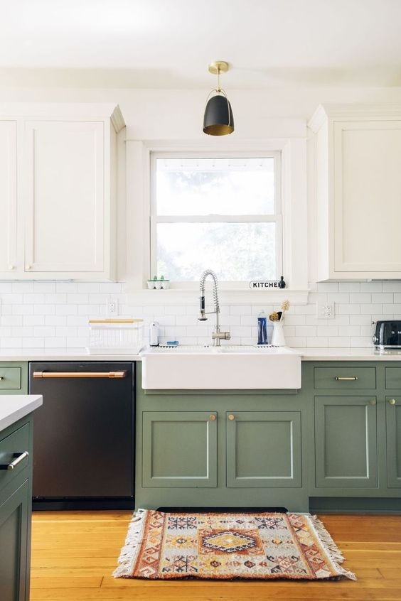 a two tone one wall kitchen with farmhouse cabinetry, a white subway tile backsplash, a white countertop and a black pendant lamp