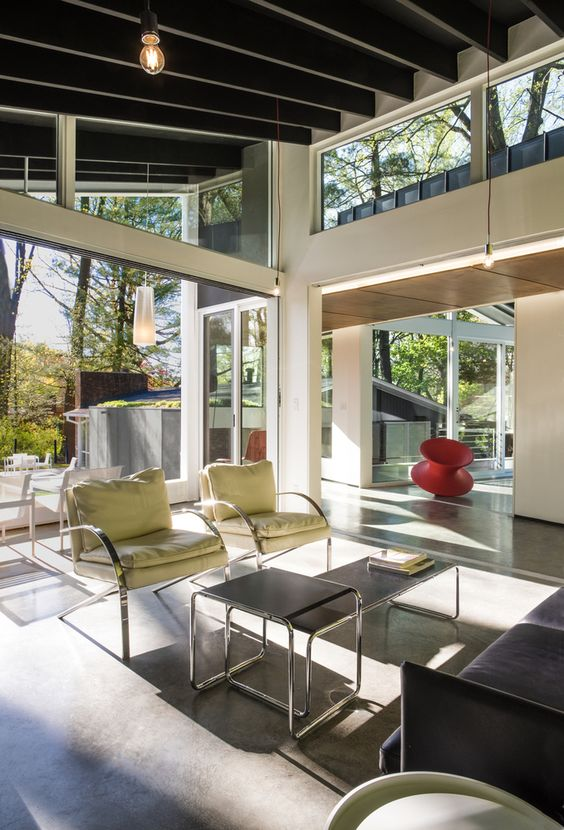 an airy and chic space with glazed walls, clerestory windows to bring more light in feels very cool and serene