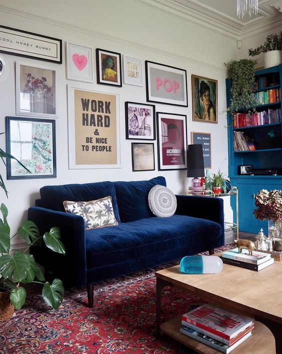 an eclectic gallery wall with mismatching art, frames and prints is a beautiful idea to go for