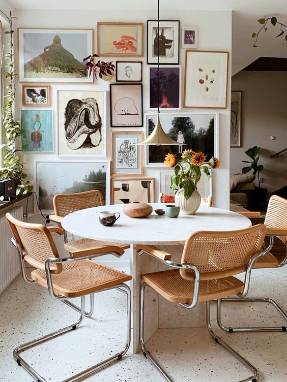 an eclectic gallery wall with various types of art in mismatching frames is amazing and looks wow