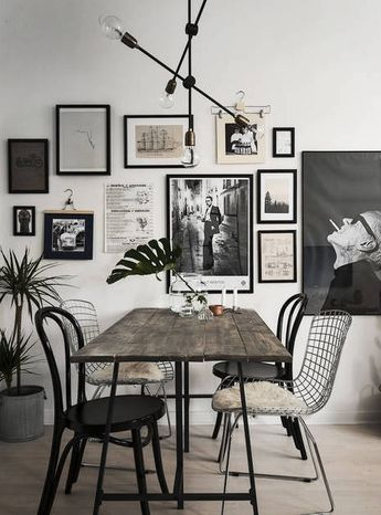 an elegant monochromatic gallery wall in black, white and neutrals, with prints and photos that inspire and impress