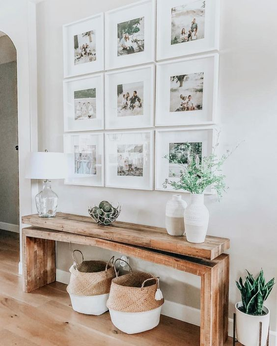 an elegant symmetrical gallery wall with matching white frames and colorful family pics is always a good idea to rock
