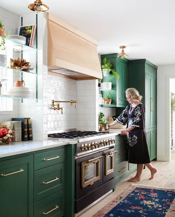 an emerald shaker style kitchen with white countertops, a wooden hood and a white square tile backsplash is amazing