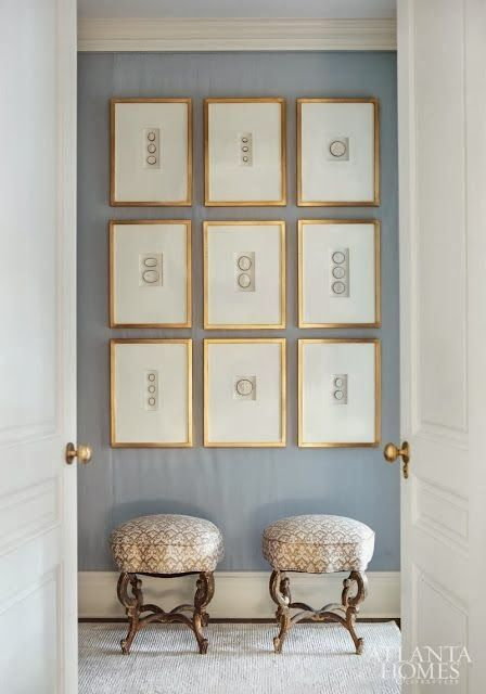 an exquisite gallery wall with gilded frames, much matting and matching decorative objects inside is a cool idea