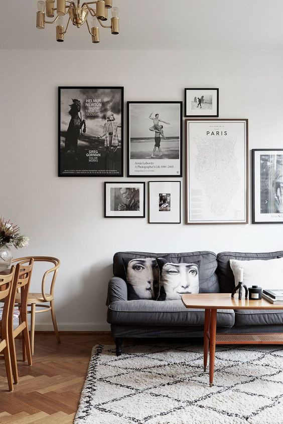 an exquisite gallery wall with mismatching black frames and black and white artworks is a very chic idea to rock