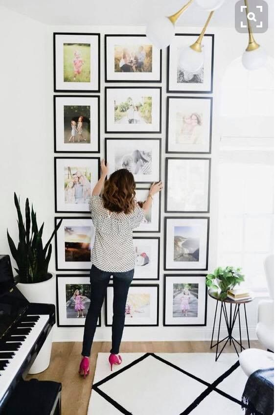 an eye-catchy grid gallery wall with thin black frames that mismatching in sizes but still form a rectangle