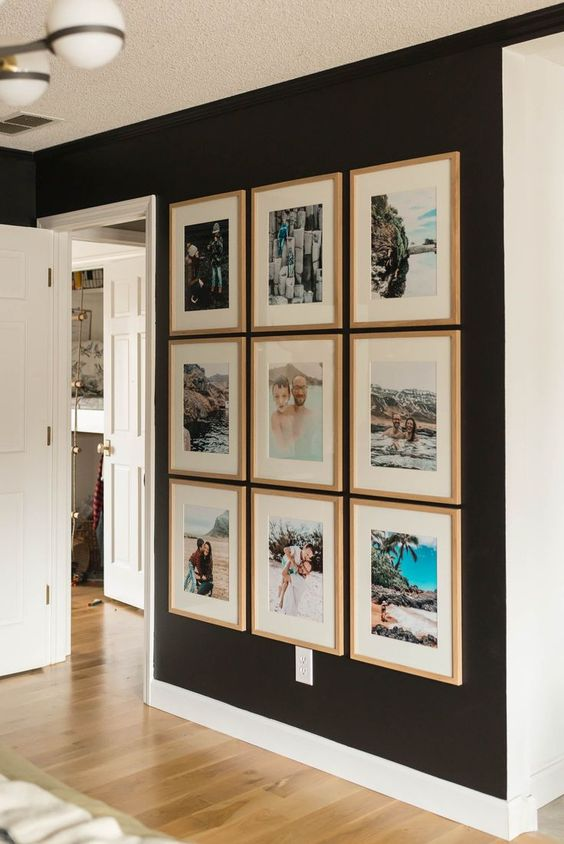 an inspiring symmetrical gallery wall with colorful photos from vacations in matching wood frames will raise your best memories