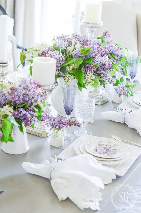 lush lilac arrangements in white vases amd white candles for a refined vintage-inspired spring tablescape