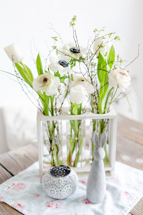 tube vases in a frame, with white blooms, greenery branches and twigs is a simple and cute centerpiece for spring