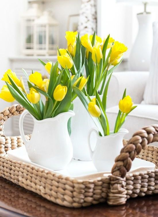 white milk jugs with yellow tulips is a lovely and easy cluster centerpiece for a rustic spring tablescape