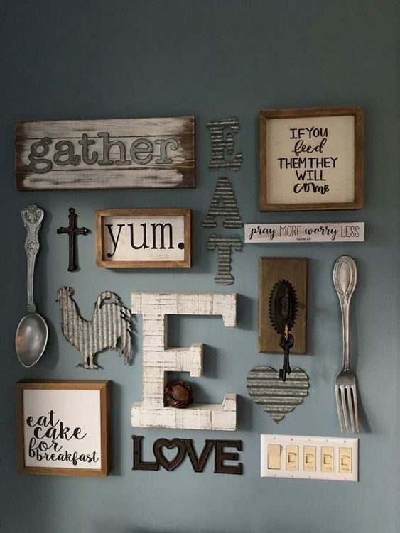 a farmhouse kitchen gallery wall with framed and non framed signs, with letters, monograms and silhouettes of wood and metal