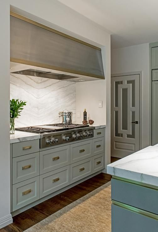 a cooking surface plus a matching hood over it and storage drawers is a cool space for cooking and it matches the cabinetry