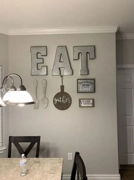 06 rustic kitchen wall decor with metal letters, wooden cutlery, a GATHER sign, a metal and a framed sign is lovely