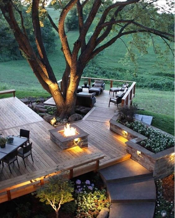 a fire pit and built-in lights make your outdoor space very welcoming and very chic