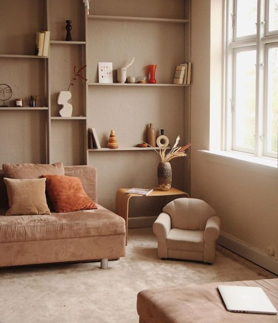 14 a neutral earthy-toned living room with greige walls, taupe and neutral furniture, built-in shelves and much natural light