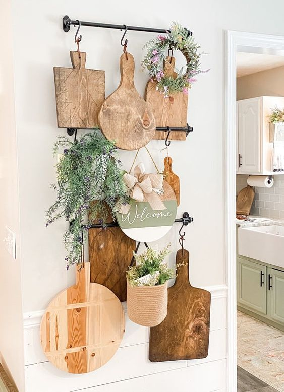 rustic kitchen wall decor with railings, cutting boards, greenery, potted and in a wreath is a lovely easy to realize idea