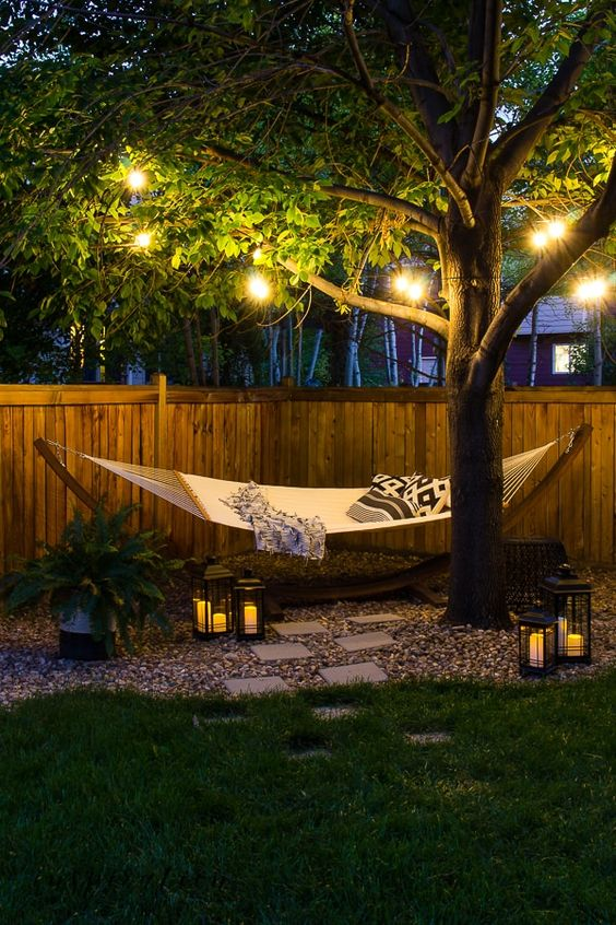 string lights and candle lanterns make this space more welcoming and cozy and accent it a lot