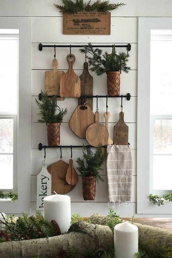 18 rustic kitchen wall decor with railings, cutting boards, potted greenery and a towel is a chic and natural idea