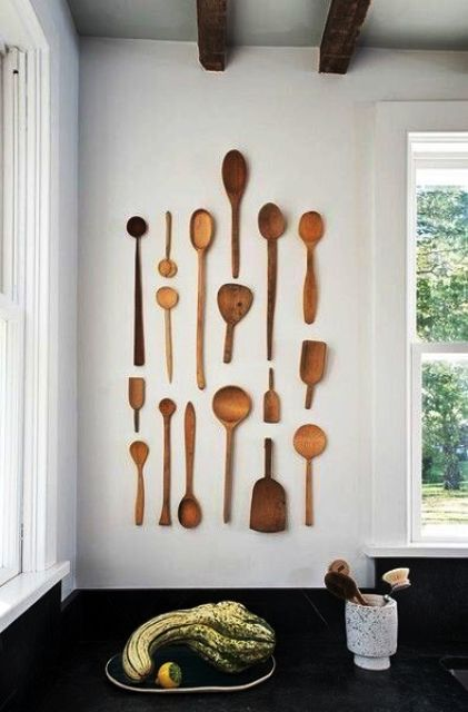 simple rustic kitchen wall decor done with wooden spoons of various sizes and looks is a lovely and cool idea to cozy up the space