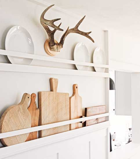 lovely neutral farmhouse wall decor with cutting boards and white plates is a great idea for a kitchen or dining space