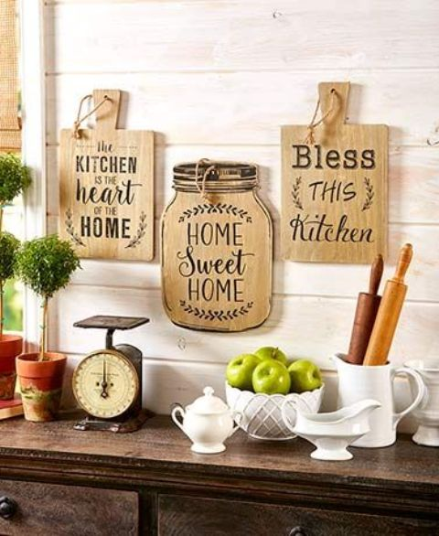 lovely rustic wall decor with cutting boards and a jar with letters is a lovely idea for a farmhouse kitchen
