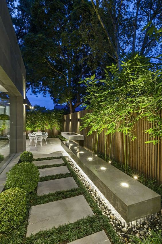 an outdoor space lit up with hidden lights, with built-in lights looks modern, fresh and bold and is very lit up