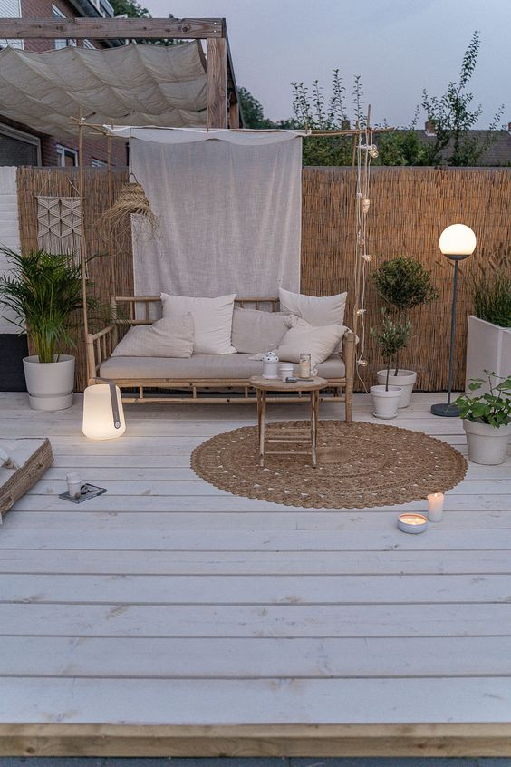 some candles, string lights and innovative mobile modern lamps light up the space and make it very stylish