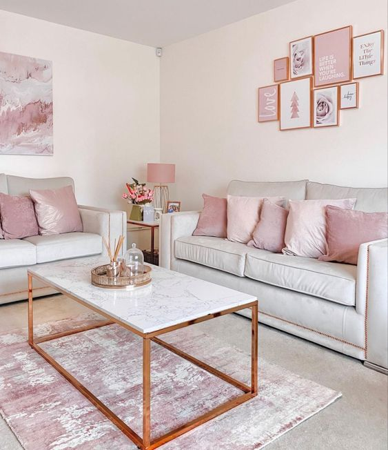 40 a simple and modern living room with grey sofas, pink and blush pillows and a rug, a pink gallery wall