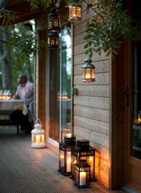 hanging and floor candle lanterns all around will make the space feel very intimate and welcoming