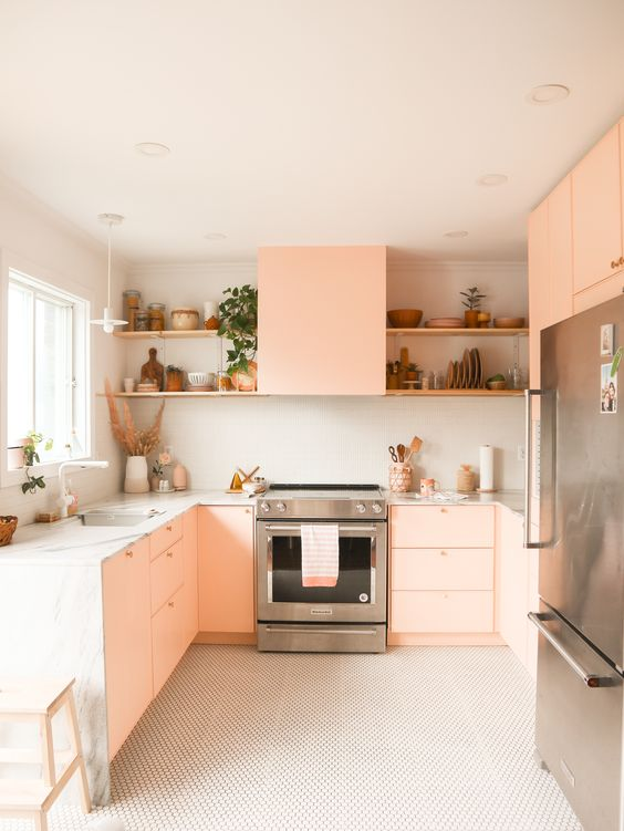 45 a modern blush pink kitchen with white stone countertops, built-in shelves and potted plants is chic and cool