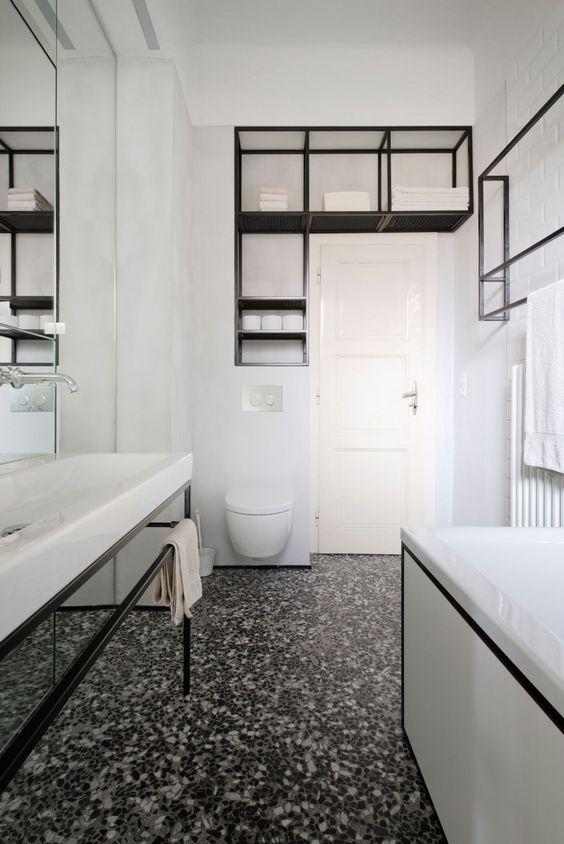 a cool bathroom design in b&w tones