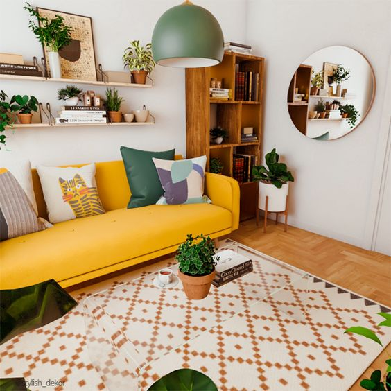 a bold modern living room with a yellow sofa, a bookcase, lots of potted greenery and a geometric print rug