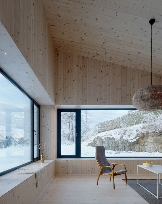 a chalet space with blonde wood cladding the walls, floors and ceilings looks amazing, welcoming and very cozy