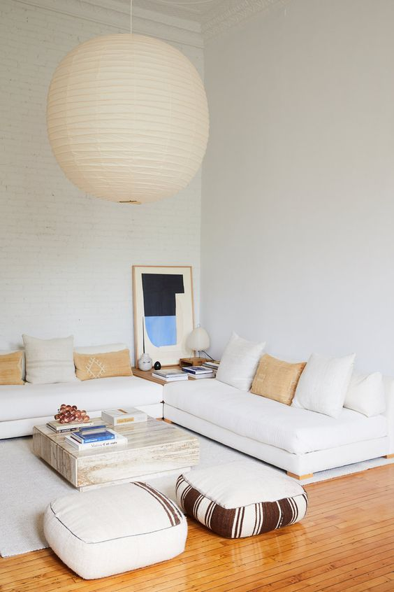 a neutral living room design with a low sofa