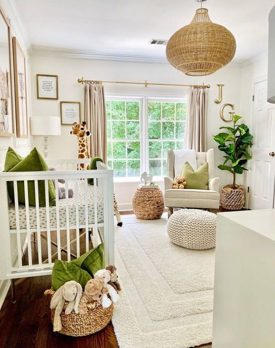 a cozy neutral nursery spruced up with green touches - pillows and blankets, with a woven pendant lamp and baskets for a cozy feel