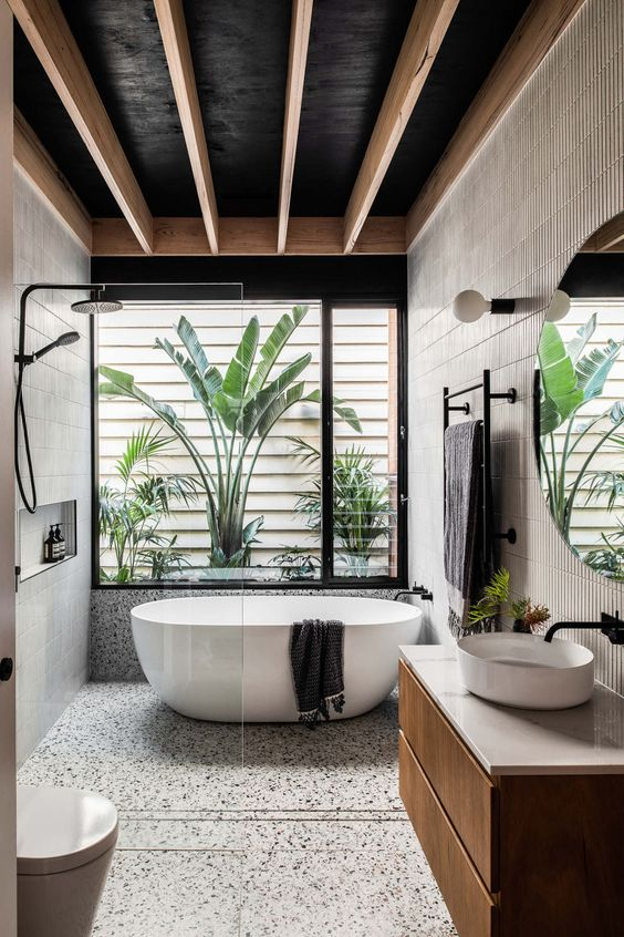a cozy tropical bathroom design
