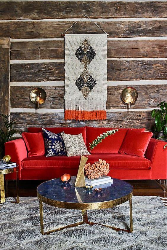 a cozy living room design with a bright red sofa